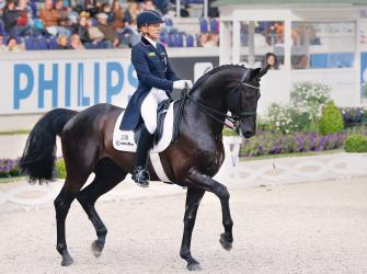 Ingrid Klimke rides in a dressage contest, Chio, 20 June 2013